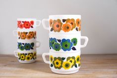 Three vintage ARCOPAL coffee cups LOTUS design 70s - French vintage coffee mug by Arcopal - Blue, yellow, orange Arcopal coffee or tea cups by LesIndecisesFrance on Etsy https://www.etsy.com/au/listing/485646469/three-vintage-arcopal-coffee-cups-lotus