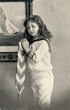 Child in sailor suit (Vintage postcard) ~~ although the child' hair is long, it might very well be a little boy, since they wore their hair quite long at the time, and little girls were more often pictured wearing dresses, with large bows in their hair.