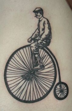 Penny Farthing Tattoo by Defeated Amoeba, via Flickr