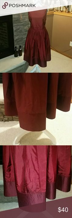 ISAAC MIZRAHI By Target Dress Beautiful burgundy dress. In great shape and has a beautiful exaggerated hem. True to size. Has loops for a belt or wrap. Doesn't come with belt or wrap. Isaac Mizrahi Dresses
