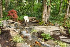 Pathway to a small patio and bench beside a water feature. | Paradise Restored Landscaping and Exterior Design, Portland, OR