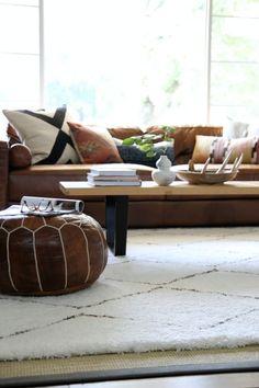 light rug to lighten up a  living room room full of dark furniture.