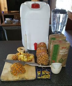 Step 1: What We Need  Ingredients  4 Pineapples (about 600g each). Make sure they are nice and ripe. Remove the crown and any loose leaves, but do not peel!  1 cup of sugar per liter of water, about 22 cups or 4kg  22 liters of very hot water  2 x 20g packets of granulated yeast (Brewer's yeast)    Equipment  25 liter container/fermentation tank  Blender (sort of optional)  Measuring cup and funnel  Cutting board and knife  Enough 2 liter plastic softdrink bottles to bottle your brew. I…