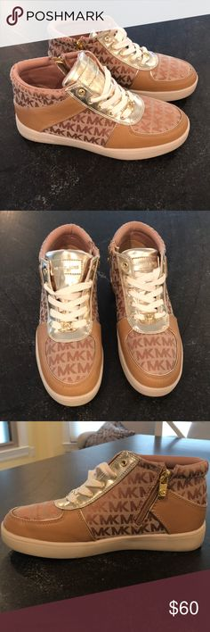 Michael Kors sneakers Michael Kors sneakers. Only worn once for about an hour. Excellent condition! Zipper detail on inner side of each shoe. Youth size 5, which equates to women's size 7. Tan and gold. Michael Kors Shoes Sneakers
