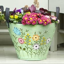 Give your garden a makeover with this bright, colourful hand painted recycled tyre planter.