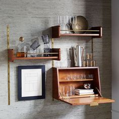 Mid-century shelving and bar. OoooOOo, good job, West Elm. Love the wall tracks.