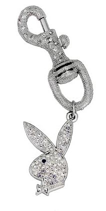 "Stunning Playboy Bunny Bag Jewel Clip Decorate your purse or backpack with this Playboy bunny jewel clip. Stately 5"" in total length, the bunny is 2"" tall. Playboybunny face is covered with clear gemstones and a dark blue gem eye. Shipped in gift packaging. $29.95 #playboy #bunny #clip"