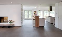 House in Amsterdam with beautiful large format Mosa Tile floors. Nice use of fireplace to break up open plan. Love the shelves at the end.