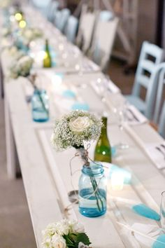 mason jars but clear wrapped with ribbon and sprinkles of diamonds on table cloth