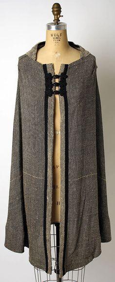 Cape Designer: Elizabeth Hawes  (American, Ridgewood, New Jersey 1903–1971 New York) Date: 1955–65 Culture: American Medium: silk Dimensions: Length at CB: 36 1/2 in. (92.7 cm) Credit Line: Gift of Dr. Barnes Riznik and Joseph Quentin Riznik, 1978 Accession Number: 1978.485