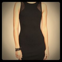 Express sheer side ponte knit dress Little black body con dress with sheer mesh sides, worn only once! If you're looking for a super sexy dress, this is it! Express Dresses Mini