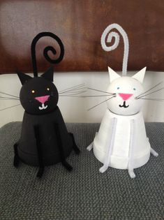 Clay pot cat craft: clay pot, doorknob, paint, pipe cleaners, felt, foam