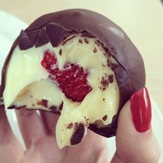 "Bombom de morango - basically, mix condensed milk and milk powder together to form a ""dough,"" then wrap a strawberry, let set, then dip in chocolate! YUM."