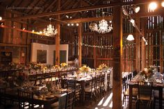 Door County Wedding | Farm Wedding | Woodwalk Gallery Wedding barnwood tables, feasting tables, chandeliers in a barn, barn dinner, barn reception  Styling by Angie McMahon photo by m three studio photography