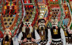 Dancers known as Kukeri perform during the International Festival of the Masquerade Game, Pernik, Bulgaria