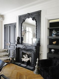 Black fireplace filled with white coral