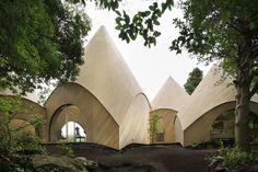 Designed for two women in their 60s, this collection of little huts is both a…