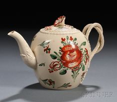 Enameled Creamware Teapot and Cover, England, late 18th century, attributed to Leeds or Derbyshire, globular shape with twisted and entwined handle terminating at florets and with a floral finial, a large flower motif to either side, ht. 4 7/8 in.