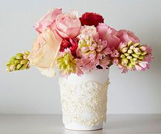 Lace-Wraped Vase - For a quick reface, simply cut beaded lace trim to fit around a vase; then, attach the lace to the back of the vase with a dot of hot glue.
