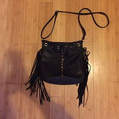 Black fringe bucket bag! Cute fringe detailing with gold triangles. Used once or twice. Bags Shoulder Bags