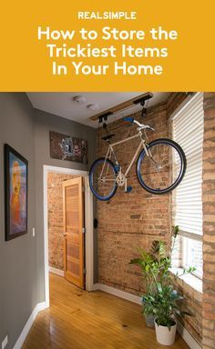 How to Store the Trickiest Items In Your Home | Outdoorsy types have their own unique organizing struggles. You see, bikes and surfboards and other sporting equipment are big. And they're really hard to store neatly at home–especially without a garage or a mudroom or even more than a few hundred square feet to work with.