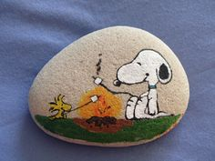 Woodstock and Snoopy painted on a Michigan Sand Stone rock
