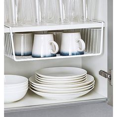 A basket that attaches to the bottom of shelves for extra storage. | 23 Things…