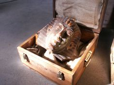 In the other cases were an earthenware Egyptian death mask and a Canopic Jar, a...