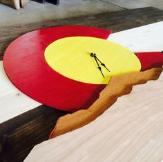 Vibrant Colorado Flag tied into a mountain back by ColoRADocarved, $150.00