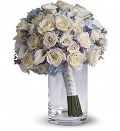 FDH #Lady_Grace_Bouquet :- Full of classic charm, this country-inspired #Bouquet features delicate limonium among light blue hydrangea, #White_Roses and mini callas.