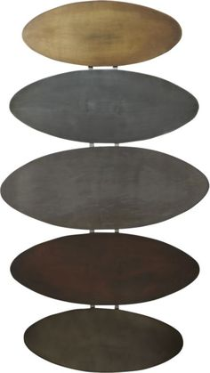 metal ceremony.  Five iron discs align as modern armor in tonal metallics.  Gold, silver, pewter, copper and bronze ovals weld a strong statement hung horizontally or vertically. Enameled ironTonal metallic discs of gold, silver, pewter, copper, bronzeHang horizontal or verticalClean with soft, dry clothMade in India.