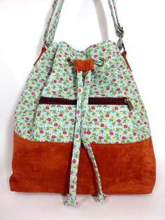 Bolsa Saquinho em tecido 100% algodão dublado , <br>com estampa floralzinha  <