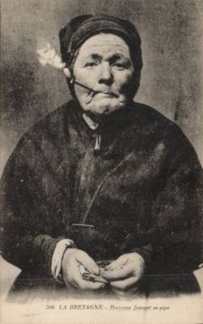 Woman in Brittany, pipe smoking