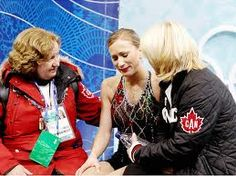 Joannie Rochette with her coaches