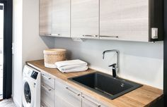 Faucet Oras Optima - with a washing machine valve - in the laundry room.