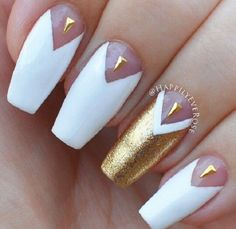 White and gold nail art design. The white polish is designed to have a v-like shape near the cuticle of the nails where it houses small gold beads in shapes of triangles.