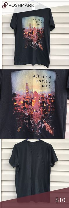 Abercrombie & Fitch men's muscle tee shirt Nice black short sleeve tee with picture of NYC on front with logo on front. 60% cotton 40% polyester. No fading, snags, stains or holes. Abercrombie & Fitch Shirts Tees - Short Sleeve