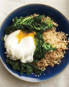 Eggs make a great anytime meal. Here, poached eggs sit on a bed of sauteed spinach and nutty quinoa. When using cooked quinoa, this cozy, healthy meal takes just 15 minutes from start to finish.