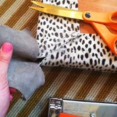 Remember the not-so-vintage bench I was going to reupholster in the spotted leather? I finished it before we went on vacation. I used my favorite corner method and thought I'd share. It's an easy approach. First I laid out the hide to figure out the pattern placement. I used these new AMAZING heavy-duty scissorsto cut …