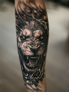 Lion tattoo, black and grey style