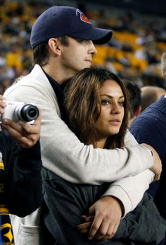 Kutcher cozies up to Kunis at a Chicago Bears game on Sept. 22, 2013