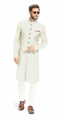 Gurhkan Off White This Off White Achkan is designed to be comfortable and elegant. It is made with the finest Italian fabrics from Vitale Barberis Canonico. Indian Wedding Suits Men, Sherwani For Men Wedding, Mens Indian Wear, Mens Ethnic Wear, Mens Sherwani, Sherwani Groom, Wedding Dress Men, Indian Men Fashion, Mens Fashion