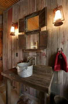 Rustic style is about making do with what you have, such as this old pail turned into a sink. It's less about whimsy than about creating a sense of invention by necessity.