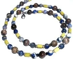 Summer colors necklace - petrified wood, opals, serpentine and sodalite beads.