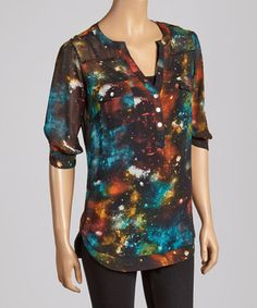 Add a dash of catwalk charisma to the closet with this button-dotted top. A color-splashed cosmic print provides sashay-worthy edge, while a casual chiffon knit keeps the fit perfectly flattering.