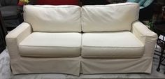 Slip covered, queen size sleep sofa.  SOLD