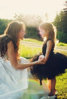 Every bride should get an adorable shot like this with their flower girl. (I also love how she is standing on her tip toes!  <3)