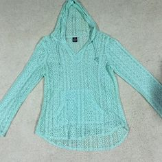 NWOT- mint lace overlay from Zumies Great top! Super cute with a tank top and leggings or as a beach cover up! This top has never been worn and needs to be!!! Hard to tell in the pic, the hem line is slightly longer in the back, let me know if you have any questions  Empyre Tops Tees - Long Sleeve