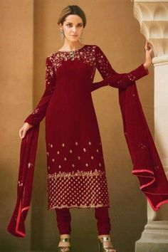 Bright and colourful, this deep red georgette trouser suit which will make all the goddesses of love and beauty to write you for your advice. This boat neck and full sleeve suit designed using thread and stone work. Paired with santoon churidar in deep red color with deep red chinnon dupatta. Churidar is plain. #trousersuit #salwarkameez #malaysia #Indianwear #Indiandresses #andaazfashion Trouser Suits, Trousers, Différents Styles, Pantalon Cigarette, Churidar Suits, Deep Red Color, Jacket Style, Indian Dresses, Indian Wear
