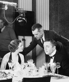 W.S. Van Dyke directs Myrna Loy and William Powell on the set of The Thin Man, 1934